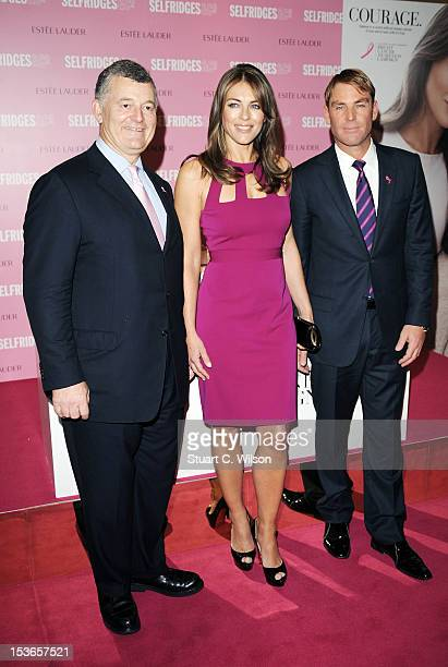 William Lauder Shane Warne and Elizabeth Hurley attend a Photocall for Estee Lauder during Breast Cancer Awareness Month at Selfridges on October 8...