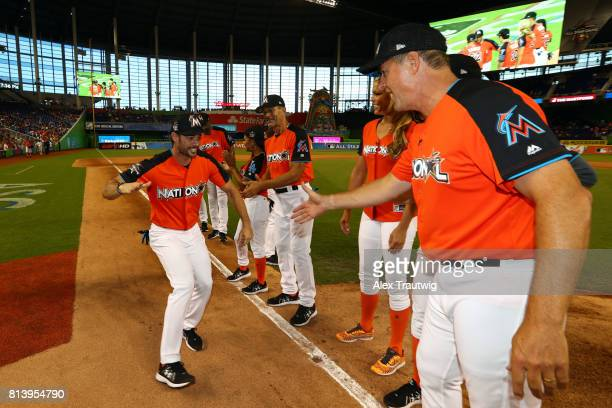 William Levy shakes hands with Al Leiter during player introductions prior to the AllStar and Legends Celebrity Softball Game at Marlins Park on...