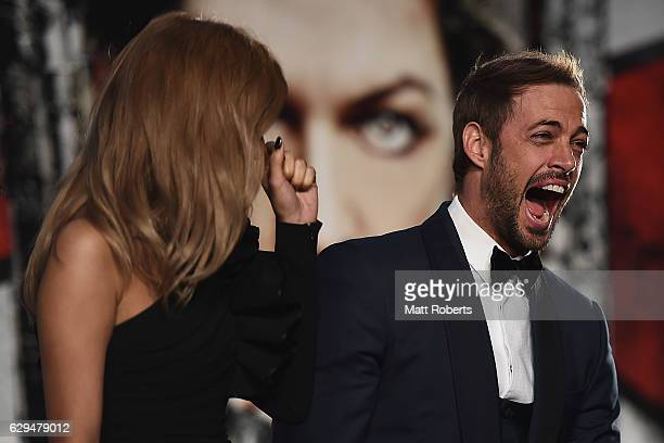 William Levy shares a laugh with Rola at the world premiere of 'Resident Evil The Final Chapter' at the Roppongi Hills on December 13 2016 in Tokyo...