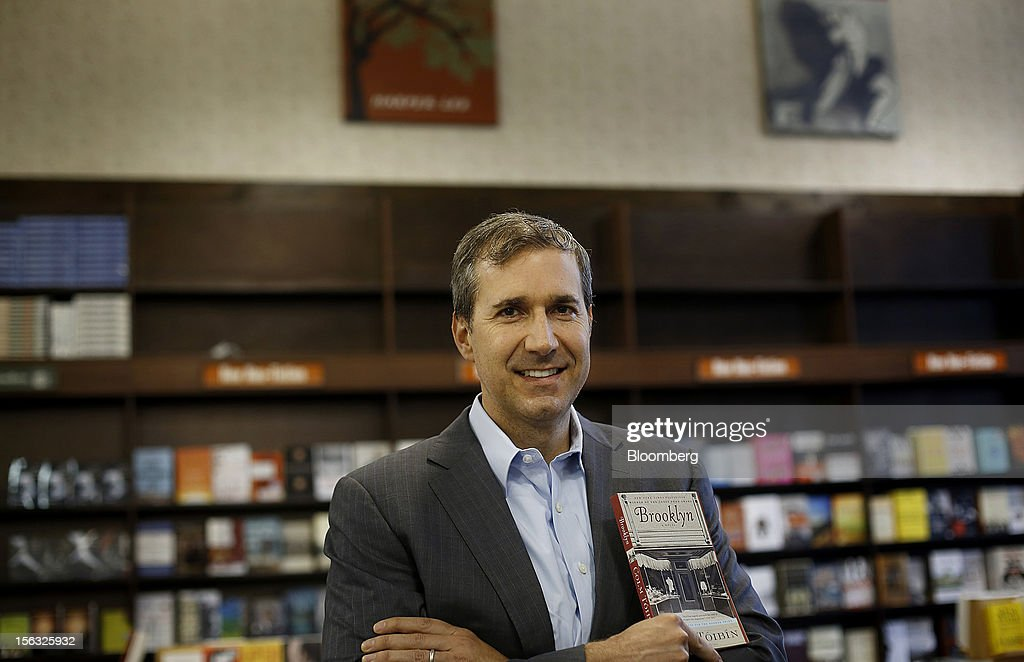 William Lynch, chief executive officer of Barnes & Noble Inc., stands for a photograph while holding 'Brooklyn', a novel by Com Toibin, prior to an exclusive Bloomberg Television interview in New York, U.S., on Tuesday, Nov. 13, 2012. Lynch discussed the company's performance, outlook and the Nook tablet. Photographer: Victor J. Blue/Bloomberg via Getty Images