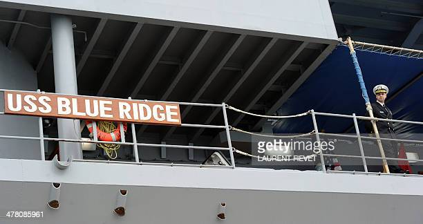 William Marks public affairs officer on the USS Blue Ridge awaits journalists for a media tour in Hong Kong on March 12 2014 The USS Blue Ridge built...