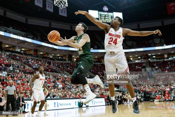 William Mary Tribe guard David Cohn lays the ball up under pressure from Ohio State Buckeyes forward Andre Wesson during a game between the Ohio...