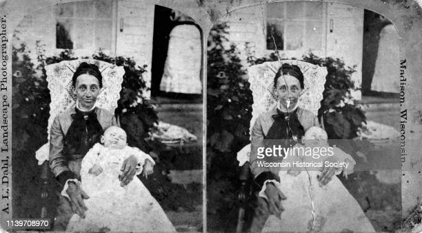 William McFarland's second wife Sela Nelson McFarland sitting with her infant son Joseph McFarland Wisconsin 1880