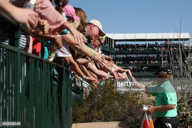 William McGirt hands out gifts to fans on the 16th hole during the third round of the Waste Management Phoenix Open at TPC Scottsdale on February 4...