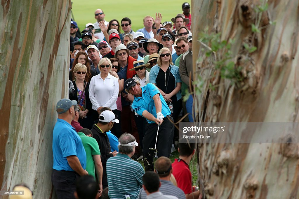 William McGirt hits a shot off the fairway on the 18th hole in the third round of the Northern Trust Open at the Riviera Country Club on February 15, 2014 in Pacific Palisades, California.