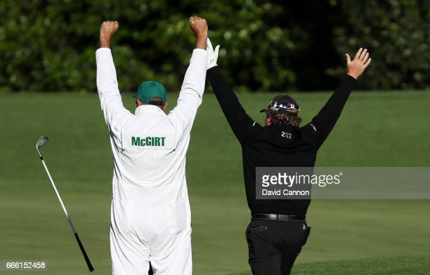 William McGirt of the United States celebrate with caddie Brandon Antus after holing his bunker shot on the fourth hole during the second round of...