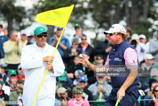 William McGirt of the United States waves after putting on the 18th green during the first round of the 2017 Masters Tournament at Augusta National...