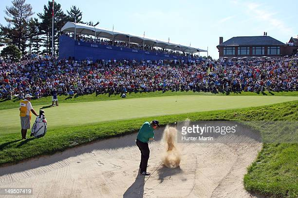 William McGirt of the US hits his third shot on the 18th hole during the final round of the RBC Canadian Open at Hamilton Golf and Country Club on...