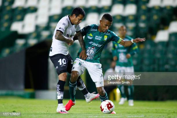William Mendieta of FC Juarez competes for the ball against William Tesillo of Leon during a match between Leon and FC Juarez as part of the friendly...