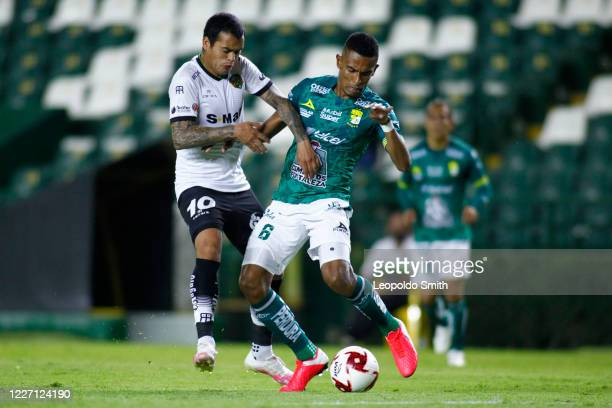 William Mendieta of FC Juarez struggles for the ball with William Tesillo of Leon during a match between Leon and FC Juarez as part of the friendly...