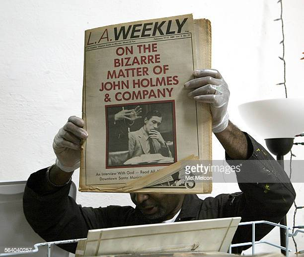 William Mitchell holds up a water damaged copy of the L.A. Weekly from 1983 that is part of photographer Gary Leonard's s 30–year collection of...
