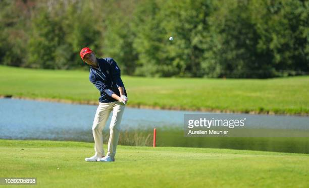 William Moll of Team USA plays an approach during the foursomes on day one of the 2018 Junior Ryder Cup at Disneyland Paris on September 24 2018 in...