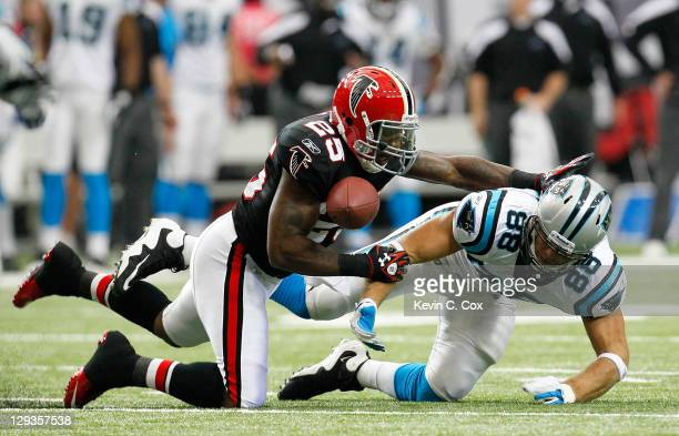 William Moore of the Atlanta Falcons breaks up a pass intended for Greg Olsen of the Carolina Panthers at Georgia Dome on October 16, 2011 in...
