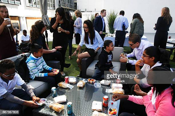 William Morris Endeavor agents have lunch with children from two schools from Compton Foster Elementary School and Whaley Middle School on the roof...