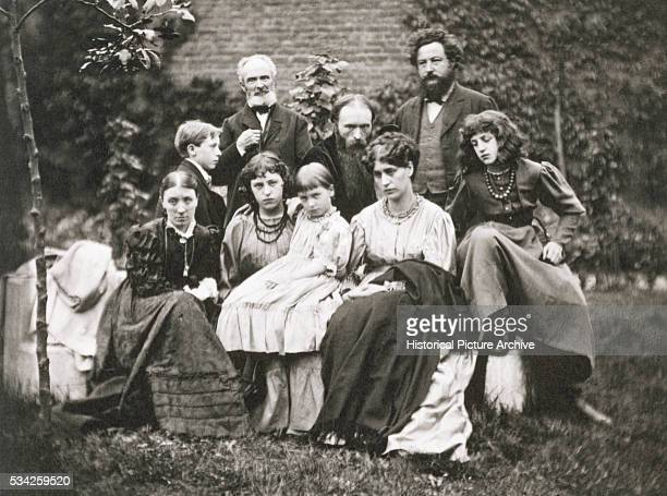William Morris stands with Sir Edward BurneJones and family