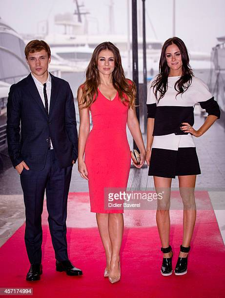 William Moseley Elisabeth Hurley and Alexandra Park pose during the photocall of 'The Royals' at Mipcom 2014 on October 13 2014 in Cannes France