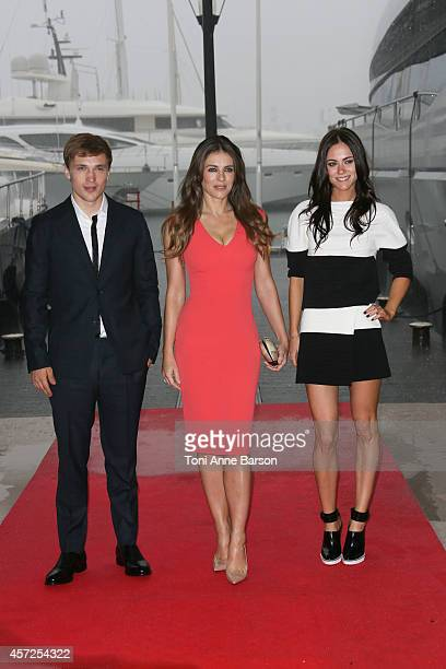 William Moseley Elisabeth Hurley and Alexandra Park pose during 'The Royals' photocall at Mipcom 2014 on October 13 2014 in Cannes France