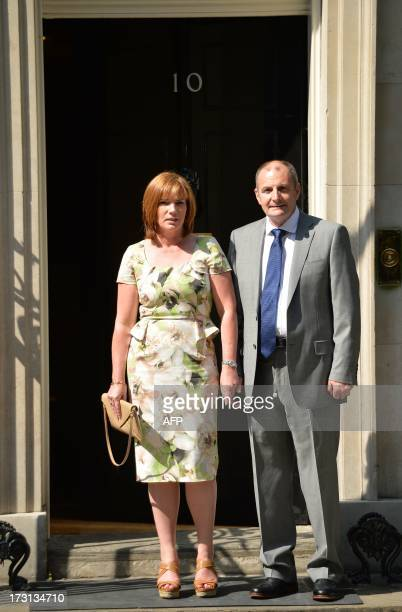 William Murray, father of Britain's tennis player Andy Murray, and his partner Sam Watson arrives at 10 Downing Street in central London on July 8...
