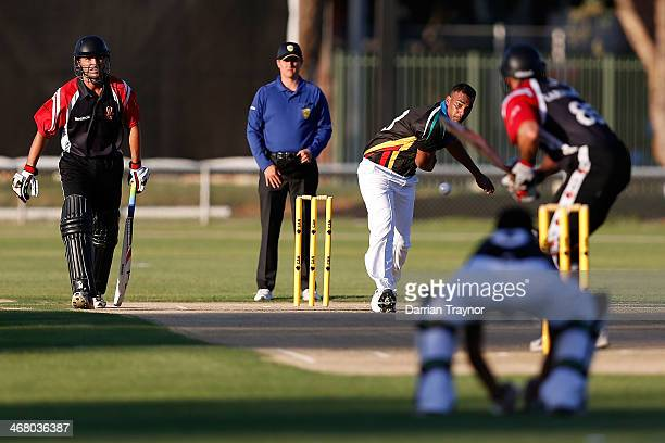 William Nona of the Black Caps bowls during the Imparja Cup match between the Black Caps and ACA at Trager Park on February 9 2014 in Alice Springs...