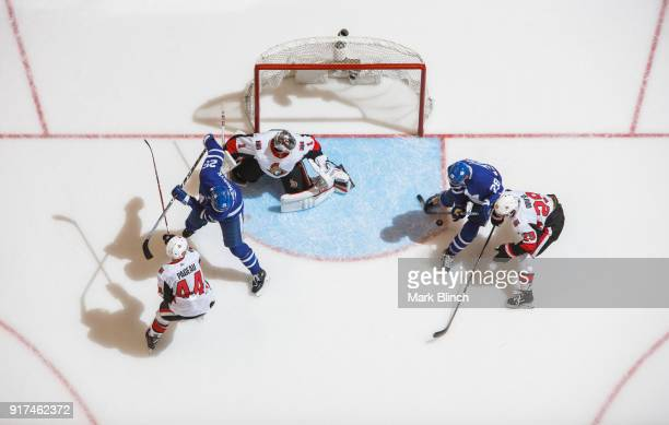 William Nylander and James van Riemsdyk of the Toronto Maple Leafs go to the net against Mike Condon Johnny Oduya and JeanGabriel Pageau of the...