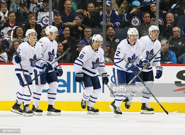 William Nylander Andreas Borgman Connor Carrick Patrick Marleau and Auston Matthews of the Toronto Maple Leafs skate back to the bench after...