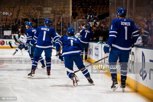 William Nylander Jake Gardiner and Nazem Kadri of the Toronto Maple Leafs wear jersey's honouring Leafs legend Johnny Bower during warmup before...