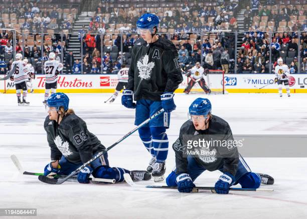 William Nylander Mitch Marner and Kasperi Kapanen of the Toronto Maple Leafs wear jerseys honouring the Canadian Armed Forces during warmup before...