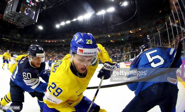 William Nylander of Sweden challenges Julius Honka of Finland for the puck during the 2017 IIHF Ice Hockey World Championship semi final game between...