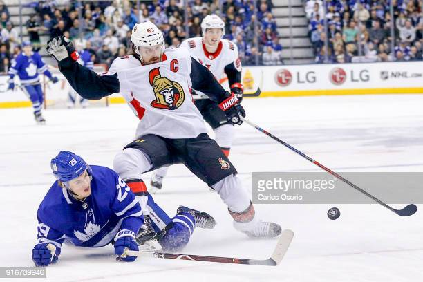 TORONTO ON FEBRUARY 10 William Nylander of the Maple Leafs battles for the puck against Erik Karlsson of the Senators during the 1st period of NHL...