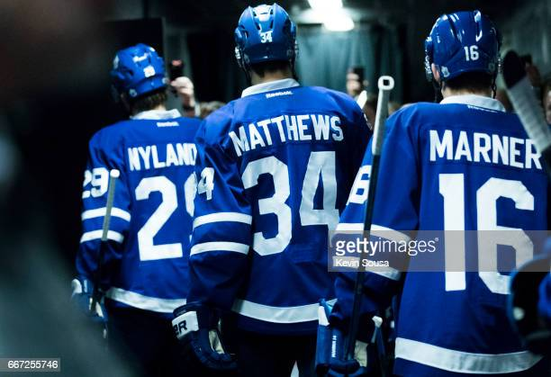 William Nylander of the Toronto Maple Leafs Auston Matthews and Mitch Marner head to the ice prior to the second period at an NHL game against the...
