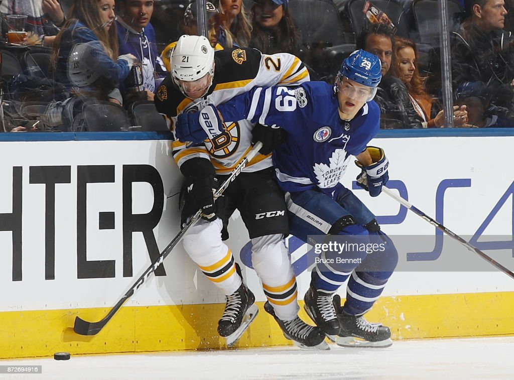 William Nylander #29 of the Toronto Maple Leafs backs into Jordan Szwarz #21 of the Boston Bruins during the third period at the Air Canada Centre on November 10, 2017 in Toronto, Canada. The Leafs defeated the Bruins 3-2 in overtime.