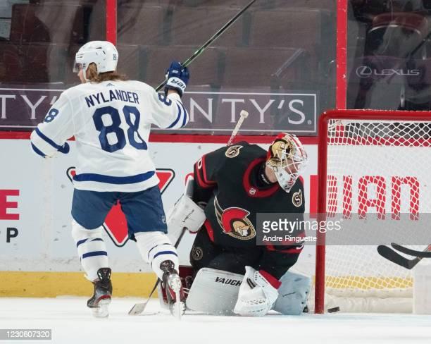 William Nylander of the Toronto Maple Leafs celebrates a third period goal against Matt Murray of the Ottawa Senators at Canadian Tire Centre on...