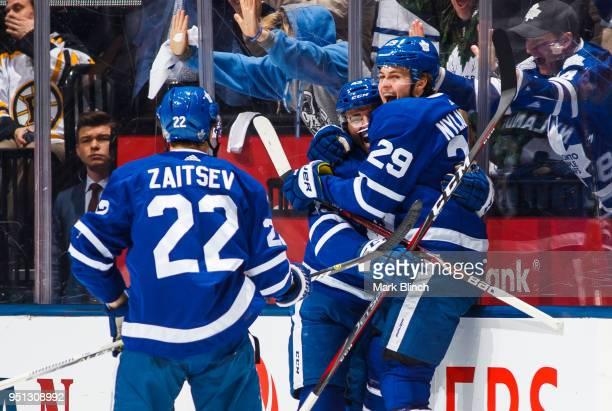William Nylander of the Toronto Maple Leafs celebrates his goal with teammates Nikita Zaitsev and Nazem Kadri against the Boston Bruins in Game Six...