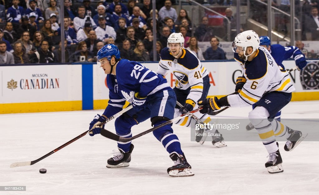 William Nylander #29 of the Toronto Maple Leafs gets away from Justin Falk #41 and Marco Scandella #6 of the Buffalo Sabres and then scores during the second period at the Air Canada Centre on April 2, 2018 in Toronto, Ontario, Canada.