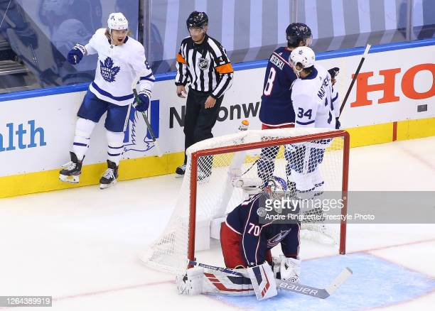 William Nylander of the Toronto Maple Leafs is congratulated by his teammate Auston Matthews after scoring a goal past Joonas Korpisalo of the...