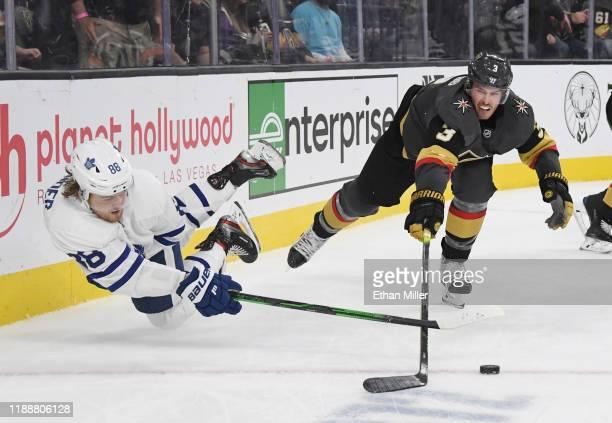 William Nylander of the Toronto Maple Leafs passes against Brayden McNabb of the Vegas Golden Knights in the third period of their game at T-Mobile...