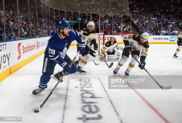 William Nylander of the Toronto Maple Leafs plays the puck against Sean Kuraly of the Boston Bruins during the first period during Game Six of the...
