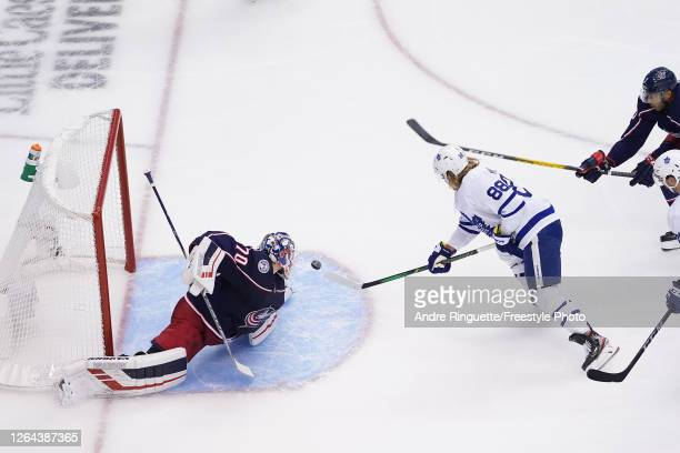 William Nylander of the Toronto Maple Leafs scores a goal past Joonas Korpisalo of the Columbus Blue Jackets during the second period in Game Three...