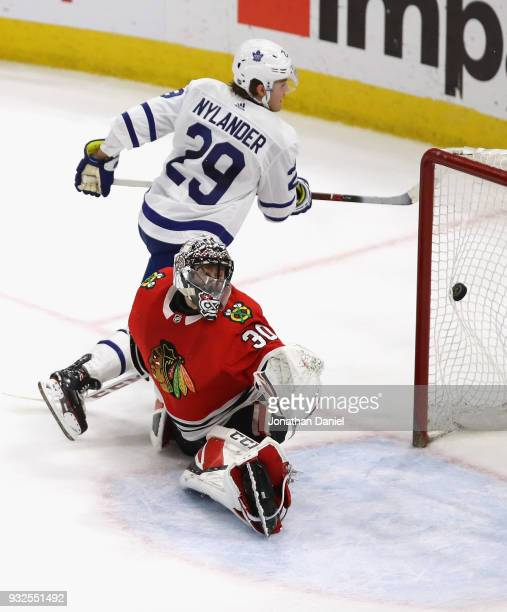 William Nylander of the Toronto Maple Leafs scores the game winning goal against Jeff Glass of the Chicago Blackhawks on a penalty shot at the United...