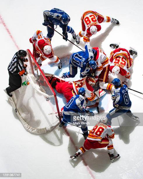William Nylander of the Toronto Maple Leafs scores the tying goal against David Rittich of the Calgary Flames during the third period at the...