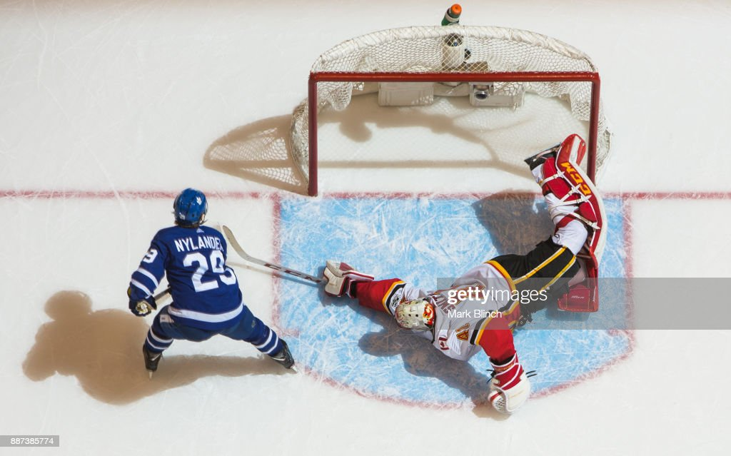 William Nylander #29 of the Toronto Maple Leafs scores the winning goal on Mike Smith #41 of the Calgary Flames during a shootout at the Air Canada Centre on December 6, 2017 in Toronto, Ontario, Canada.