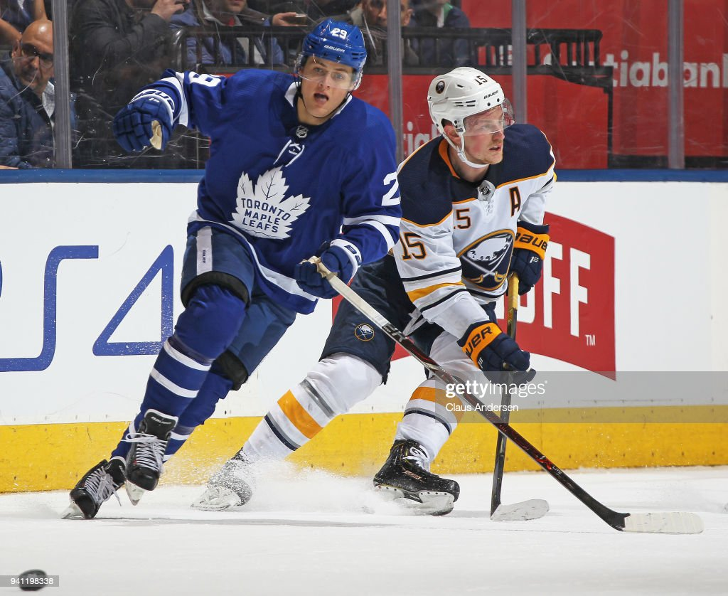 William Nylander #29 of the Toronto Maple Leafs skates after the puck against Jack Eichel #15 of the Buffalo Sabres during an NHL game at the Air Canada Centre on April 2, 2018 in Toronto, Ontario, Canada. The Maple Leafs defeated the Sabres 5-2.