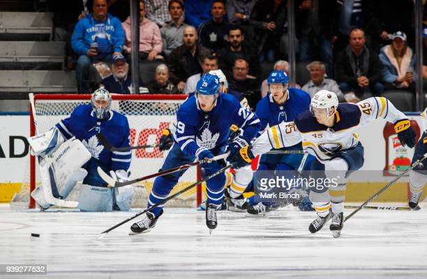 William Nylander of the Toronto Maple Leafs skates against the Brendan Guhle of the Buffalo Sabres during the first period at the Air Canada Centre...