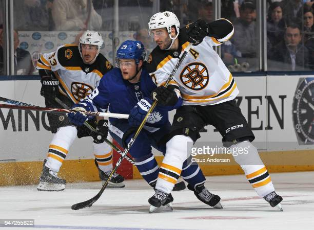 William Nylander of the Toronto Maple Leafs skates between Patrice Bergeron and Brad Marchand of the Boston Bruins in Game Three of the Eastern...