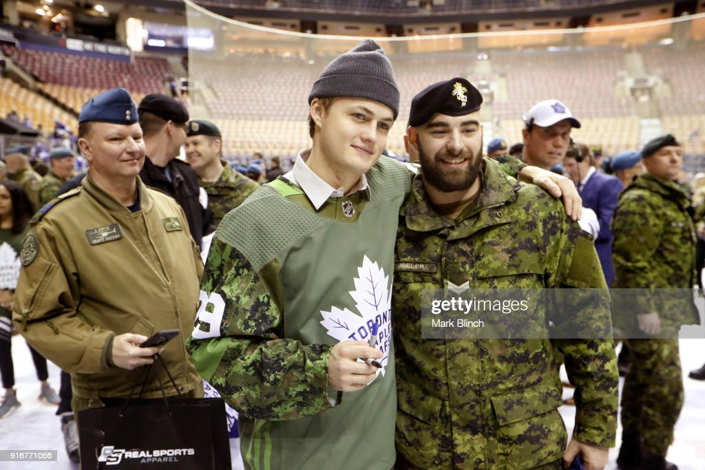 William Nylander #29 of the Toronto Maple Leafs stands for pictures with members of the Canadian Armed Forces after the Leafs defeated the Ottawa Senators at the Air Canada Centre on February 10, 2018 in Toronto, Ontario, Canada.