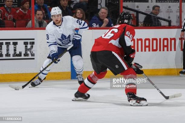 William Nylander of the Toronto Maple Leafs stickhandles the puck against Christian Wolanin of the Ottawa Senators at Canadian Tire Centre on March...