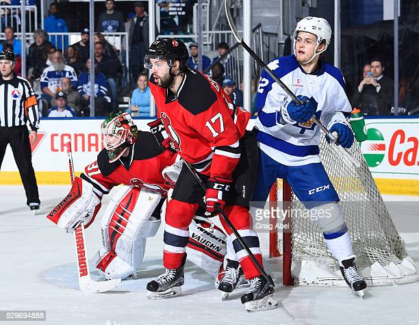 William Nylander of the Toronto Marlies battles for crease space with Scott Wedgewood and MarcAndre Gragnani of the Albany Devils during AHL playoff...