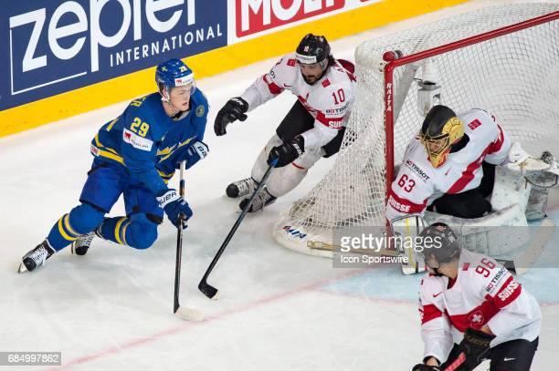 William Nylander tries to score against Anders Ambuhl and Goalie Leonardo Genoni during the Ice Hockey World Championship Quarterfinal between...