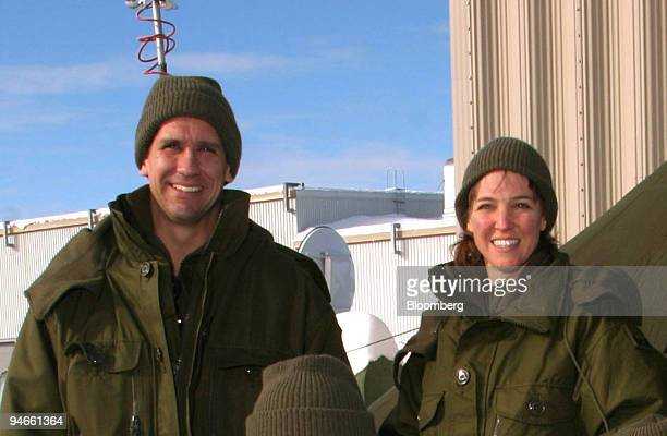 ID William Oefelein of NASA left and Lisa Nowak of NASA pose during winter training in Valcartier Quebec Canada Jan 21 2004 Nowak who flew aboart...