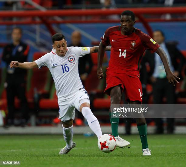 William of Portugal national team and Martin Rodriguez of Chile national team vie for the ball during FIFA Confederations Cup Russia 2017 semifinal...